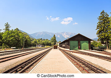 Railway station against beautiful blue sky and far mountains