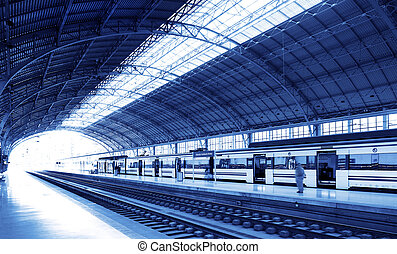 Railway station on blue tone - Railway station with train...