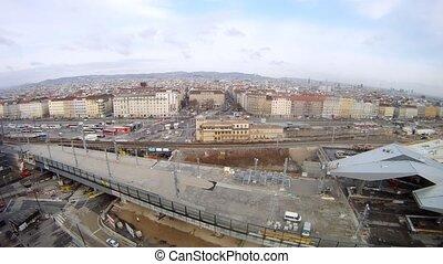 Railway station stands against city landscape, time lapse