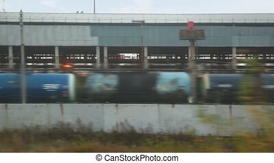 railway station with freight train of tank waggons, view...