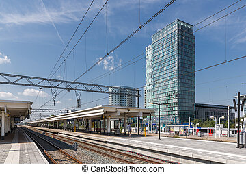 Railway station with office buildings in Amsterdam, capital city of the Netherlands