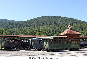 railway station with old wagons and steam locomotive