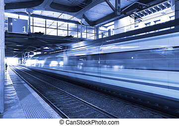 Railway station with train in movement. - Railway station...
