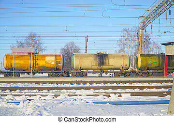Railway tanks at the station against blue sky