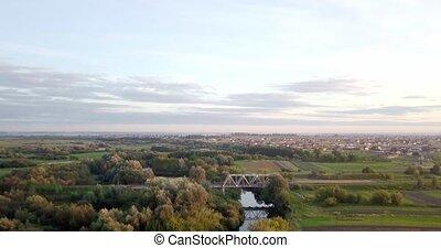 Railway through river. Railway bridge above the river. Bird...