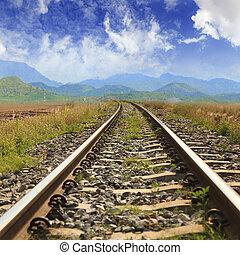Railway through the mountains with blue sky