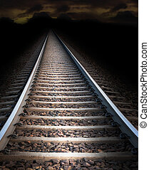 Railway track at night - Low angle view of railroad track at...
