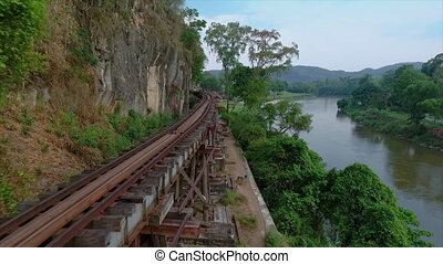 Railway track close to a cliff above a river - A high angle...