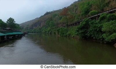Railway track close to a cliff overlooking a river - A close...