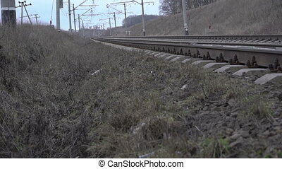 Railway track in the field, high-voltage network. Slowly...