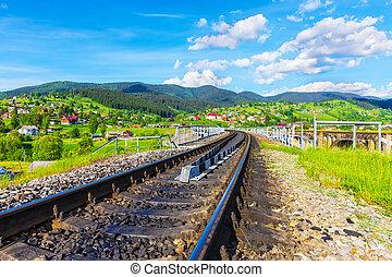 Railway track in Vorokhta, Ukraine - Scenic summer view of...