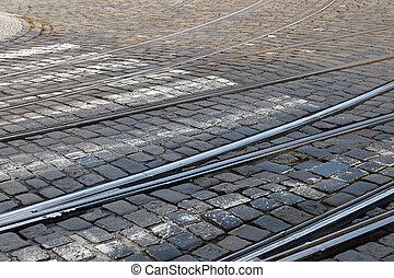 Railway track on a cobblestone street