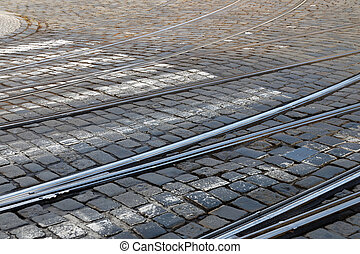 Railway track on a cobblestone street
