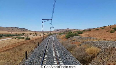 Railway tracks in a rural scene. view from last coach