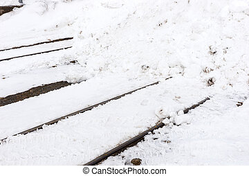 Railway tracks in winter covered with snow