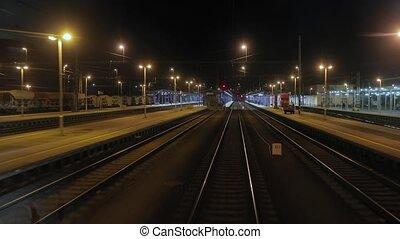 Railway tracks motion at night - Railway tracks view from ...