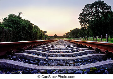 railway tracks with pale pastel sunset and frog point of...