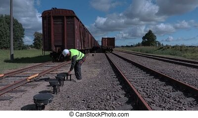 Railway worker inspecting railway stuff