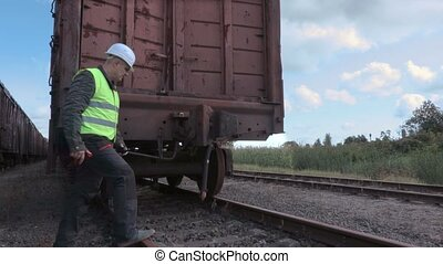 Railway worker inspecting the wagon connection