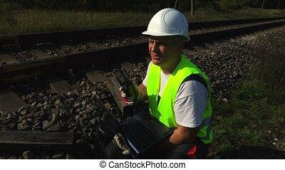 Railway worker speaking by walkie-talkie