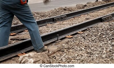 Railway workers bolting track rail