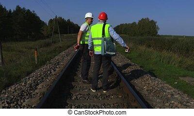 Railway workers on rails