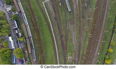 Railway yard with a lot of railway lines and trains. -...