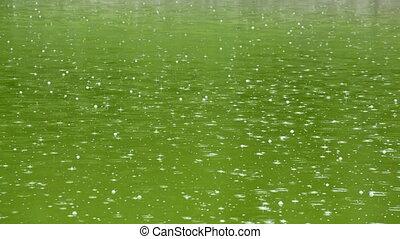 Rain above lake close up
