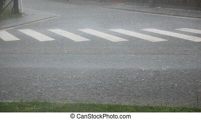 Rain and hail - Flooded street due to rains and hailing, car...