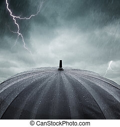 rain and thunderstorm - black wet umbrella , selective focus...