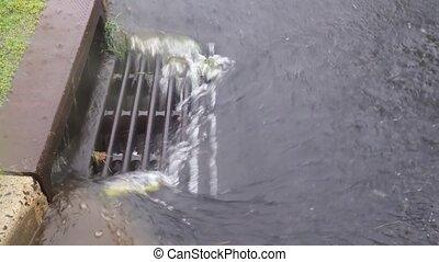 Rain at street drops falling to puddle and asphalt Rain...
