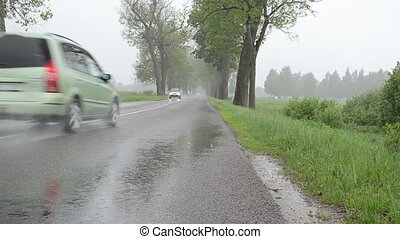 rain car asphalt road - cars automobiles driving on rural...