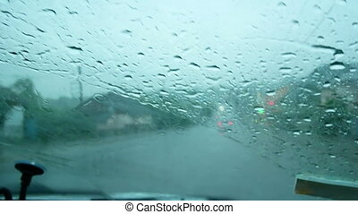 Rain car windshield storm - Rain splatters car windshield...