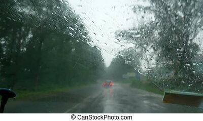 Rain car windshield storm - Rain splatters car windshield...