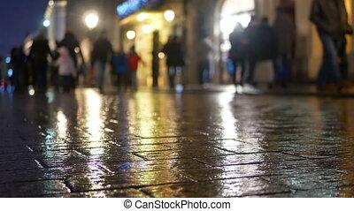 Rain city street night people