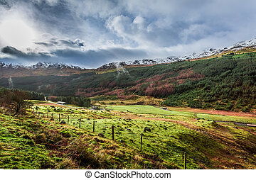 Rain clouds over a mountain valley in Scotland