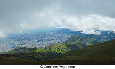 Rain clouds over the city of Quito seen from the moor of the volcano Rucu Pichincha