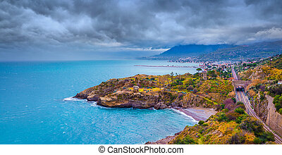 Rain clouds over the northern coast of Sicily near Palermo. ...