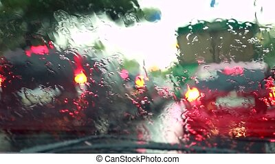 Rain drips onto the car glass, Windshield wipers wipe rain...