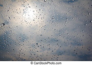 rain drop on the plastic roof with the sun light