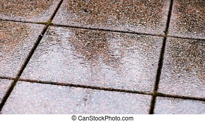 Rain dropping on tiled