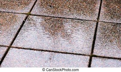 Rain dropping on tiled