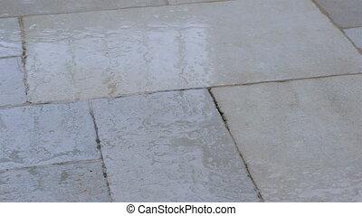 Rain drops at stone street