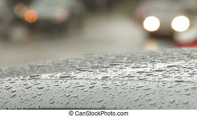 Rain drops on a car roof