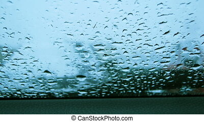Rain drops on a car window time lapse