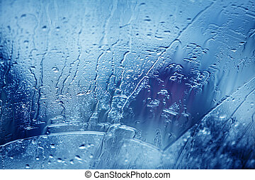 rain drops on car glass in rainy days