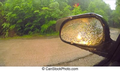 Rain Drops On Car Side View Mirror And Window