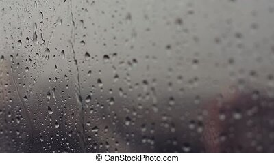 Rain drops on glass. Window. Side view shallow depth of...