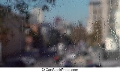 Rain drops on household windows. Blurry background - Rain...