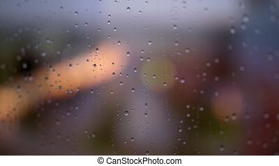 Rain drops on steamy window